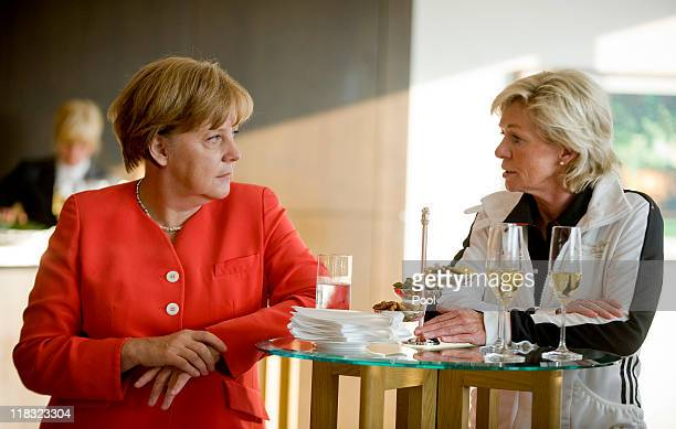 In this photo provided by the German Government Press Office German Chancellor Angela Merkel speaks to head coach of Germany Silvia Neid during her...
