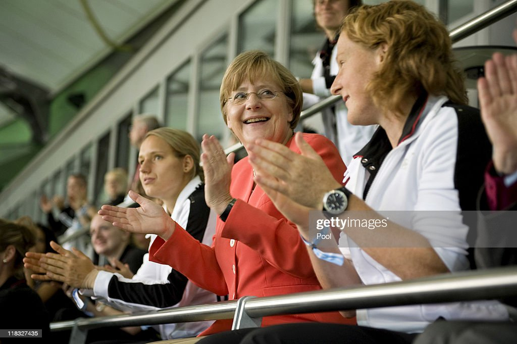 In this photo provided by the German Government Press Office, German Chancellor Angela Merkel watches the match with the German Women national team during the FIFA Women's World Cup 2011 Group C match between Sweden and USA at the Arena In Allerpark on July 6, 2011 in Wolfsburg, Germany.