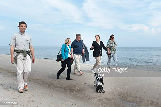 In this photo provided by the German Government Press Office German Chancellor Angela Merkel and her husband Joachim Sauer take a walk at the beach...