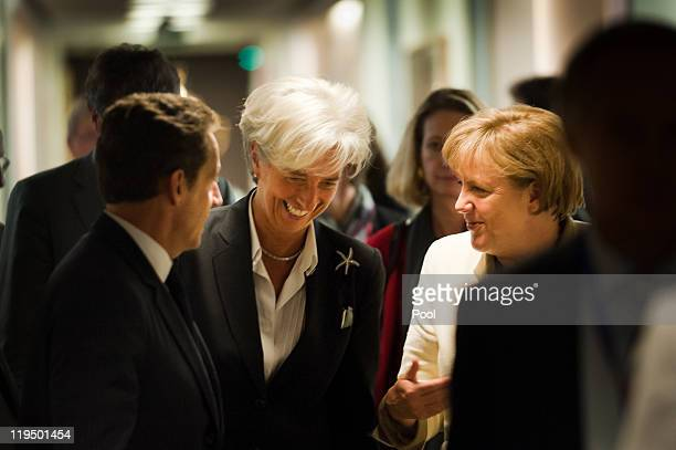 In this photo provided by the German Government Press Office German German Chancellor Angela Merkel talks to Christine Lagarde managing director of...