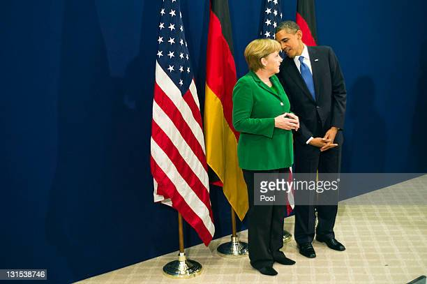 In this photo provided by the German Government Press Office German Chancellor Angela Merkel and US President Barack Obama talk ahead of the start of...