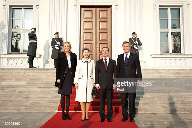 In this photo provided by the German Government Press Office German President Christian Wulff and First Lady Bettina Wulff welcome Russian President...