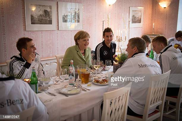 In this photo provided by the German Government Press Office German Chancellor Angela Merkel talks to German National Team players Philipp Lahm...