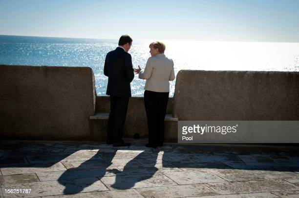 In this photo provided by the German Government Press Office German Chancellor Angela Merkel and Portuguese Prime Minister Pedro Passos Coelho speak...