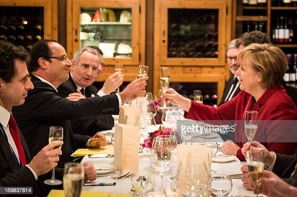In this photo provided by the German Government Press Office German Chancellor Angela Merkel and French President Francois Hollande celebrate the...