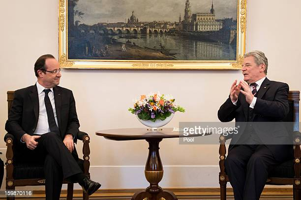 In this photo provided by the German Government Press Office German President Joachim Gauck and French President Francois Hollande meet at the...