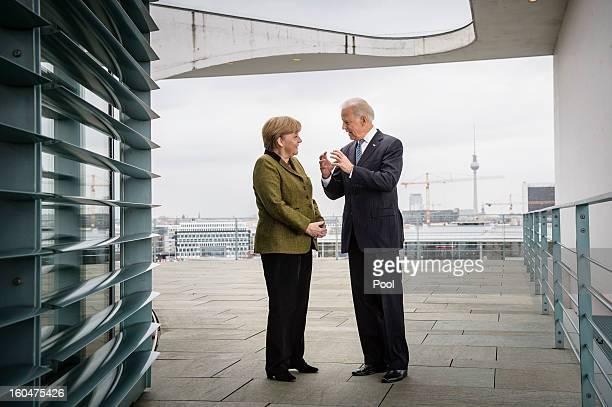In this photo provided by the German Government Press Office German Chancellor Angela Merkel speaks with US Vice President Joe Biden at the start of...