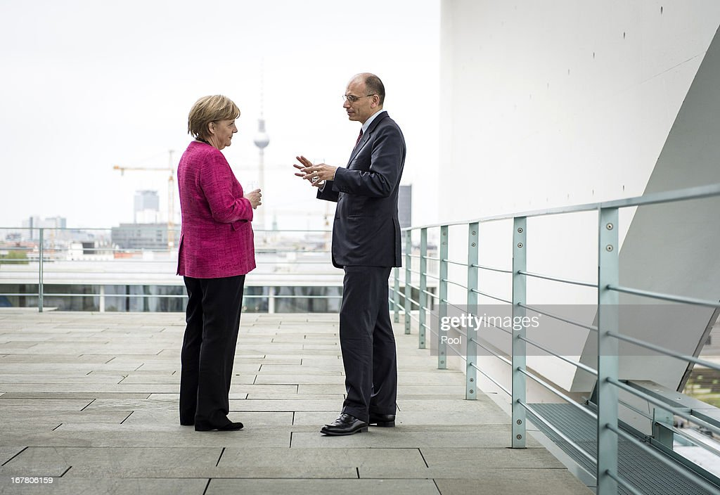 In this photo provided by the German Government Press Office (BPA), German Chancellor Angela Merkel and Italy's new Prime Minister Enrico Letta in conversation on a balcony of the Chancellery in Berlin.on April 30, 2013 in Berlin, Germany.