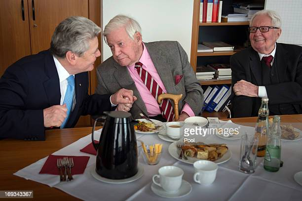 In this photo provided by the German Government Press Office German President Joachim Gauck sits alongside former German Chancellor Helmut Schmidt...