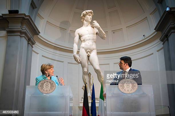 In this photo provided by the German Government Press Office German Chancellor Angela Merkel and Italian Prime Minister Matteo Renzi hold a press...