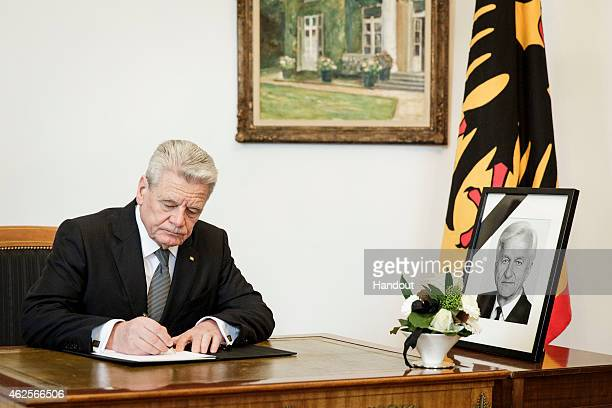 In this photo provided by the German Government Press Office , German President Joachim Gauck signs a condolence book for former German President...