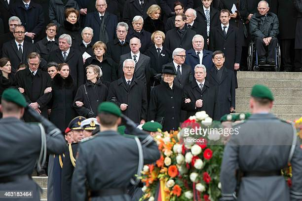 In this photo provided by the German Government Press Office German Chancellor Angela Merkel German President Joachim Gauck with the widow of the...