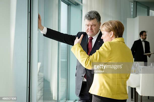 In this photo provided by the German Government Press Office German Chancellor Angela Merkel talks with President of Ukraine Petro Poroshenko in the...
