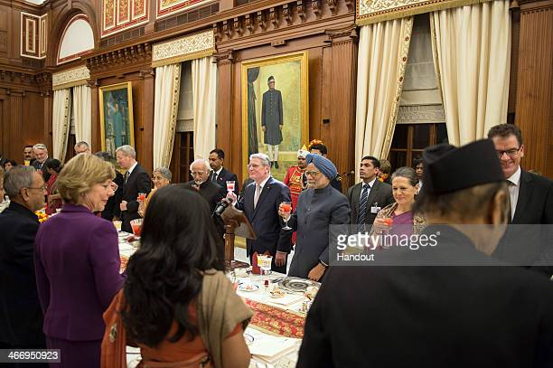 In this photo provided by the German Government Press Office German President Joachim Gauck stands next to Indian Prime Minister Manmohan Singh and...