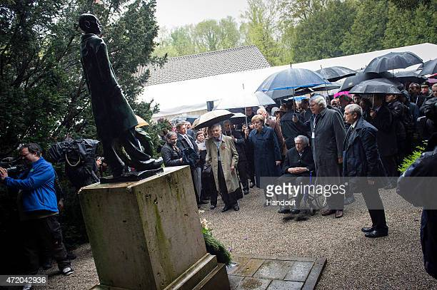 In this photo provided by the German Government Press Office German Chancellor Angela Merkel and Max Mannheimer are seen in the area of the former...