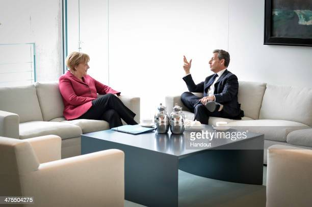In this photo provided by the German Government Press Office , German Chancellor Angela Merkel and former French President Nicolas Sarkozy meet at...