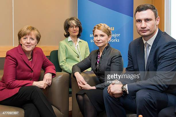 In this photo provided by the German Government Press Office German Chancellor Angela Merkel speaks with Ukranian Politicians Julia Timoschenko...