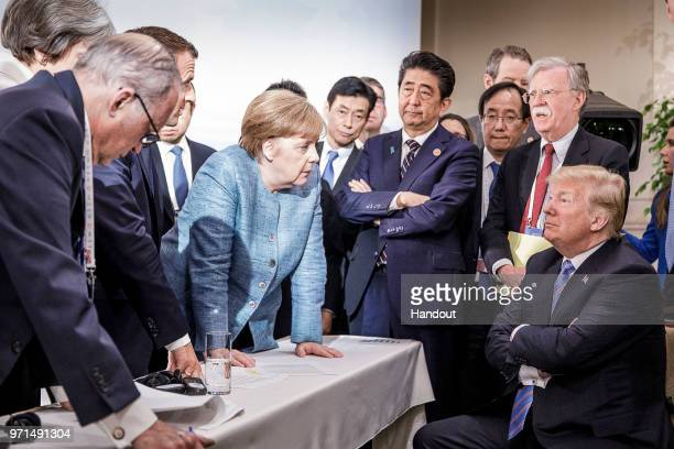 In this photo provided by the German Government Press Office German Chancellor Angela Merkel deliberates with US president Donald Trump on the...