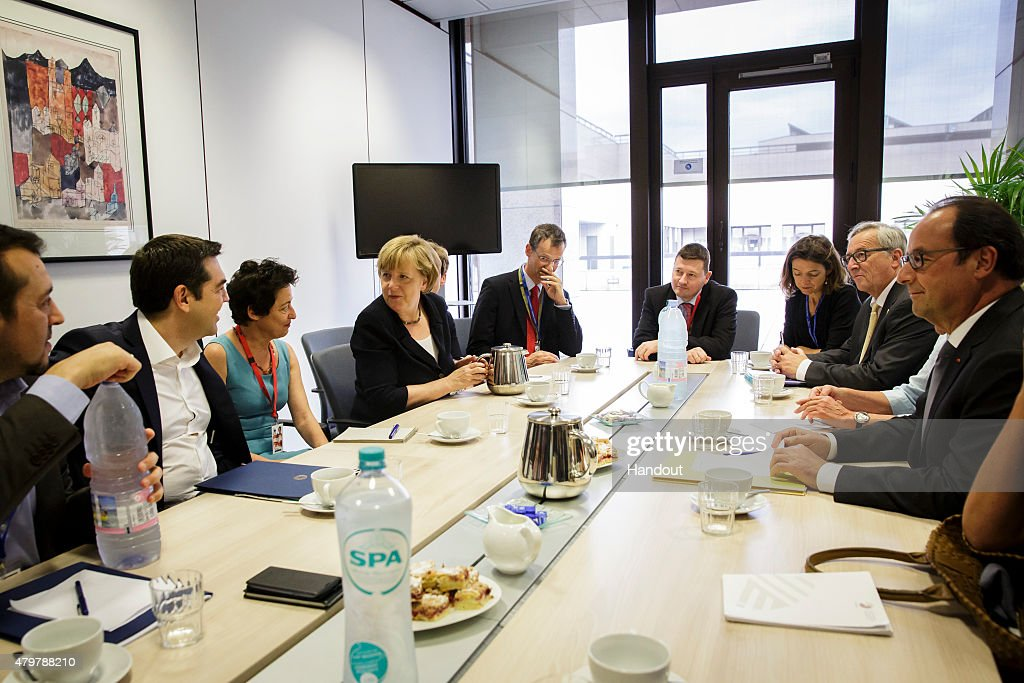 In this photo provided by the German Government Press Office (BPA), Greek Prime Minister Alexis Tsipras (2nd R), German Chancellor Angela Merkel (4th L), European Commission President Jean-Claude Juncker (2nd R) and French President Francois Hollande (R) talk during a meeting prior to the emergency Euro Summit, on July 7, 2015 in Brussels, Belgium. President of the EU Parliament Martin Schulz has said that the consequences of the Greek referendum result, which rejected the European Bailout deal with great majority, has increased the risks of national bankruptcy in Greece.