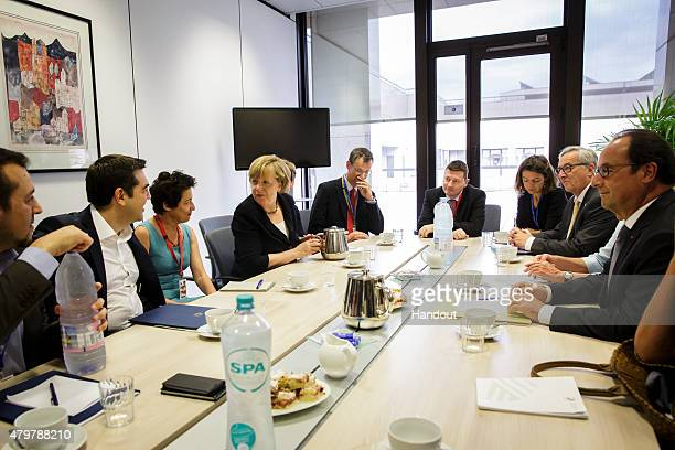 In this photo provided by the German Government Press Office , Greek Prime Minister Alexis Tsipras , German Chancellor Angela Merkel , European...