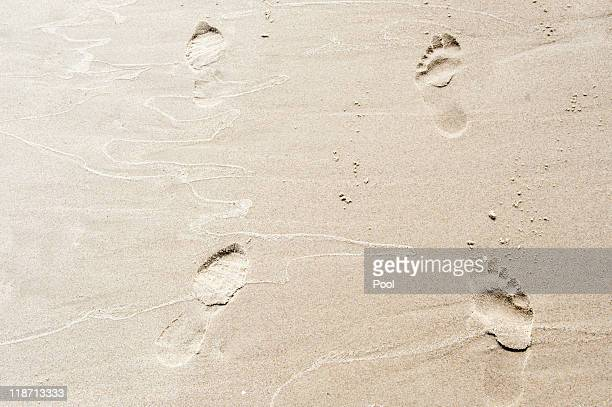 In this photo provided by the German Government Press Office footprints of German Chancellor Angela Merkel and Polish President Bronislaw Komorowski...