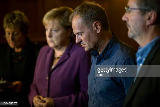 In this photo provided by the German Government Press Office Polish Prime Minister Donald Tusk gives a statement to the bus accident next to German...