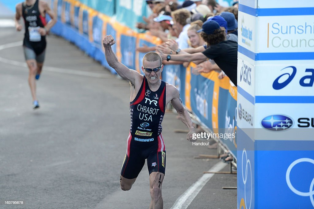 In this photo provided by the International Triathlon Union, Matt Chrabot of USA celebrates taking silver during the men's elite race at the 2013 Mooloolaba ITU Triathlon World Cup on March 16, 2013 in Mooloolaba, Australia. (Photo by Delly Carr/ITU via Getty Images).