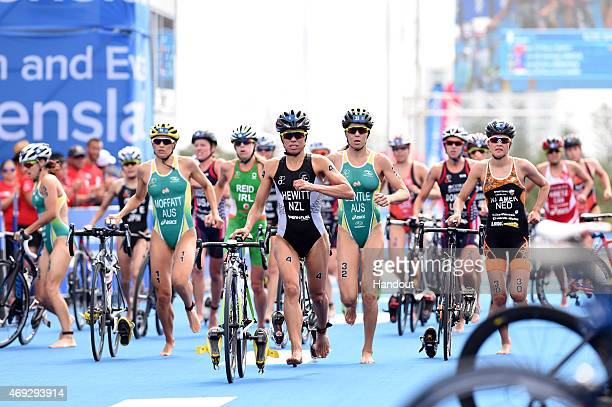 In this photo provided by the International Triathlon Union New Zealand's Andrea Hewitt leads the chase group after the bike during the ITU World...