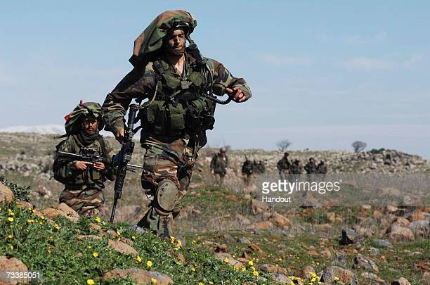 In this photo provided by the Israeli Defense Forces army paratroopers take part in a major military exercise February 21 2007 in the Golan Heights...