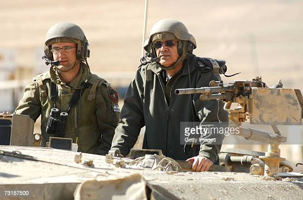 In this photo provided by the Israeli Defense Forces outgoing IDF ChiefofStaff Dan Halutz rides in a tank during a ground forces assault exercise on...