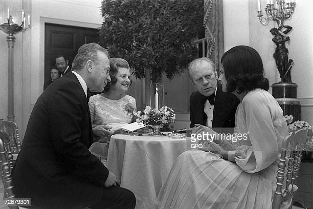 In this photo provided by the Israeli Government Press Office U.S. President Gerald Ford and his wife Betty Ford have dinner with Israeli Prime...