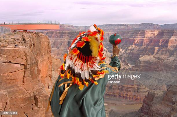 In this photo provided by the Las Vegas News Bureau Don Habatone a member of the Hualapai Indian Tribe looks out over The Skywalk at Grand Canyon...