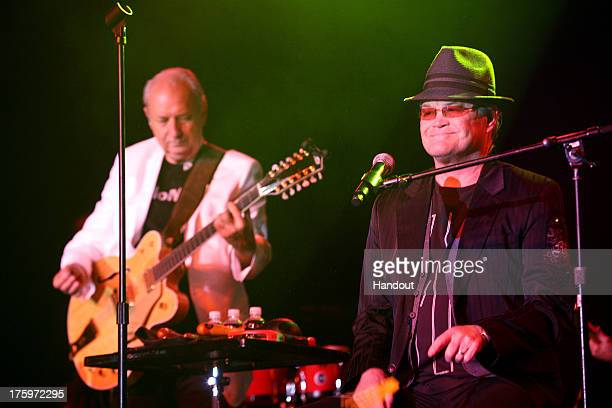 In this photo provided by the Las Vegas News Bureau Michael Nesmith and Micky Dolenz of The Monkees perform at Green Valley Ranch on August 10 2013...