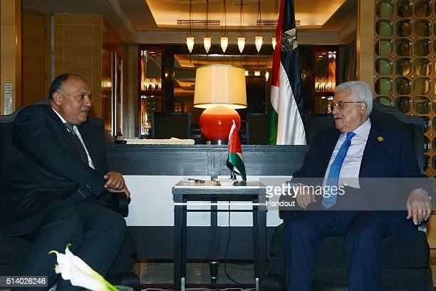 In this photo provided by the Palestinian Press Office, Palestinian President Mahmoud Abbas meets with Egyptian Foreign Minister Sameh Shoukry March...