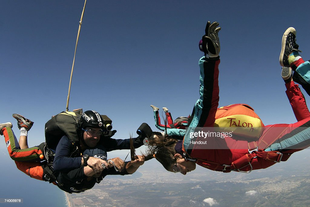 In this photo provided by the Paradive Skydiving Club on April 27, 2007, Israeli hairdresser Oren Orkobi (below left), gives Israeli woman Sharon Har-Noy a haircut (R) while skydiving April 25, 2007 over Habonim Beach in northern Israel. Paradive said the haircut was an attempt to enter the Guinness Book of World Records as the world's first skydiving haircut. Orkobi is skydiving in tandem with Ido Holtz, a Paradive instructor.
