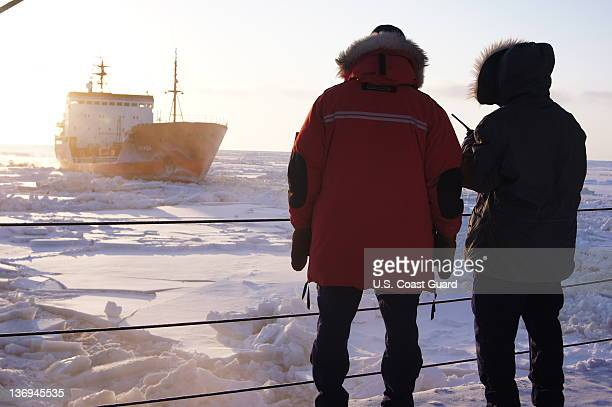 In this photo provided by the US Coast Guard crewmembers of the US Coast Guard Cutter Healy observe the Russian tanker vessel Renda as it follows...