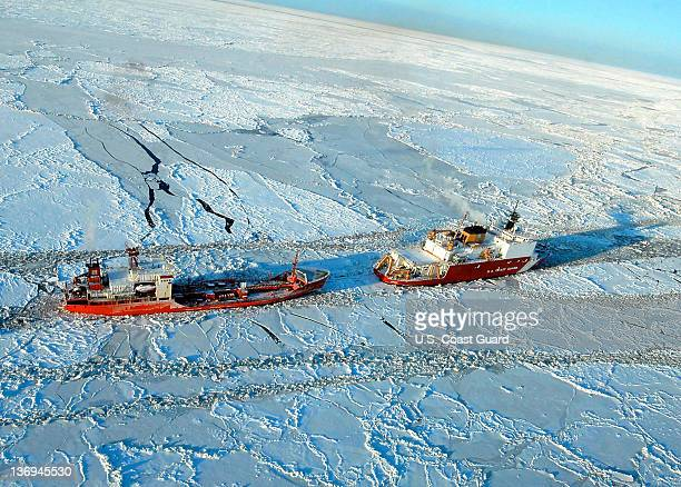In this photo provided by the U.S. Coast Guard, the Russian tanker Renda powers toward Nome, Alaska with the U.S. Coast Guard Cutter Healy's...