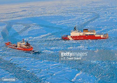 In this photo provided by the US Coast Guard the Russian tanker Renda powers toward Nome Alaska with the US Coast Guard Cutter Healy's assistance...