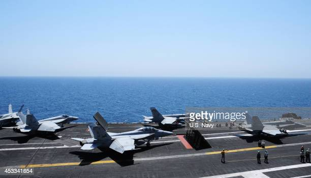 In this photo provided by the U.S. Navy, aircraft launch from the flight deck of the the aircraft carrier USS George H.W. Bush on August 7, 2014 in...