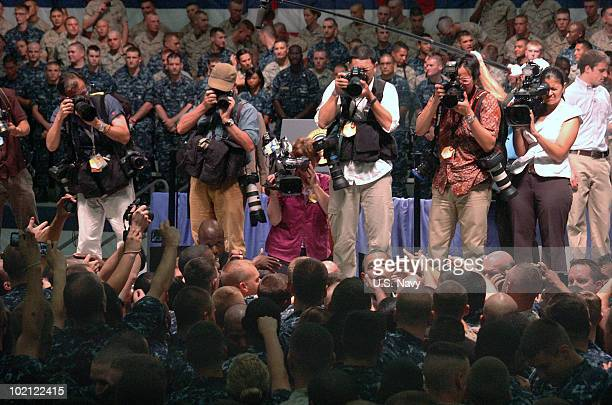 In this photo provided by the US Navy journalists document President Barack Obama as he greets Sailors and Marines at the Naval Air Technical...