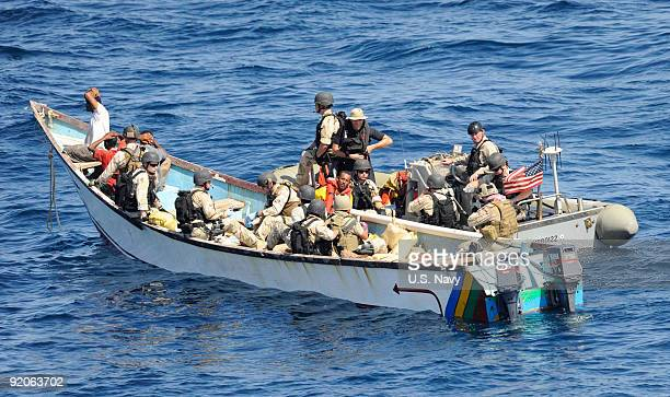 In this photo provided by the US Navy Members of a visit board search and seizure team from the guidedmissile cruiser USS Anzio and US Coast Guard...