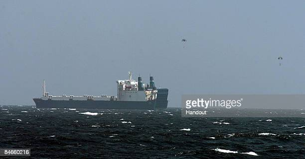 In this photo provided by the US Navy ransom money is dropped near the Ukrainian cargo ship MV Faina while under observation by a US Navy ship...