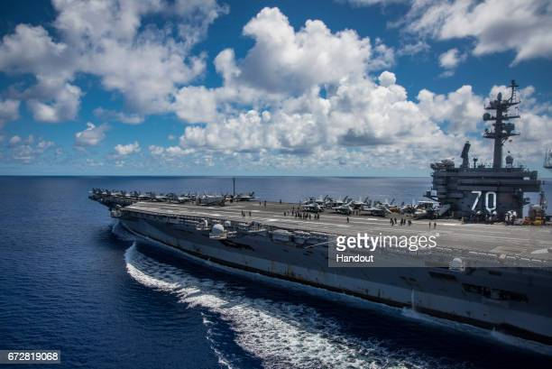 In this photo provided by the U.S. Navy, the USS Carl Vinson transits the Philippine Sea while conducting a bilateral exercise with the Japan...