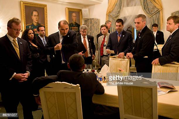 In this photo provided by The White House during a day of meetings in Moscow Russia US President Barack Obama is briefed by advisors Press Secretary...