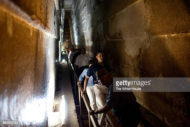 In this photo provided by The White House President Barack Obama carefully descends a steep flight of steps on a tour of the Pyramids of Giza with...
