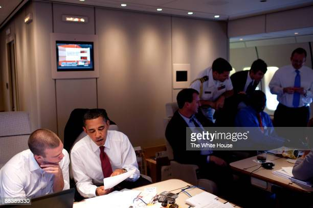 In this photo provided by The White House President Barack Obama talks to Head Speech Writer Jon Favreau aboard Air Force One June 5 2009 enroute to...