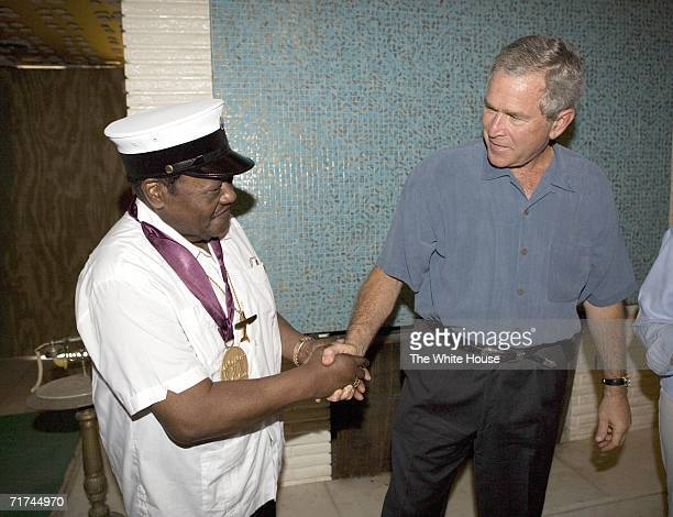 In this photo provided by the White House President George W Bush shakes hands with legendary musician Fats Domino wearing a National Medal of Arts...