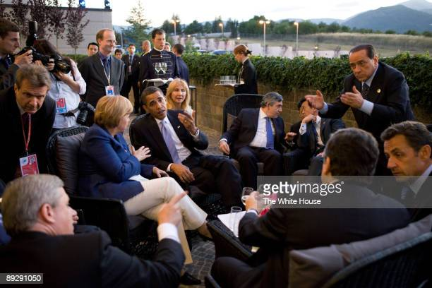 In this photo provided by The White House, U.S. President Barack Obama confers with world leaders, Canadian Prime Minister Stephen Harper, German...