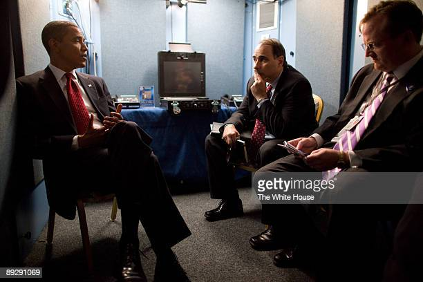 In this photo provided by The White House US President Barack Obama confers with Senior Advisor David Axelrod and Press Secretary Robert Gibbs after...