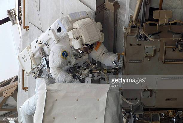 In this photo released by NASA on February 14 US space shuttle Atlantis Mission Specialist German Hans Schlegel moves along the International Space...